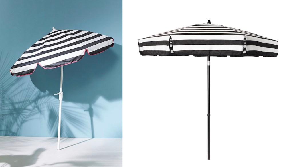 black and white stripe umbrella with blue wall next to stock photo