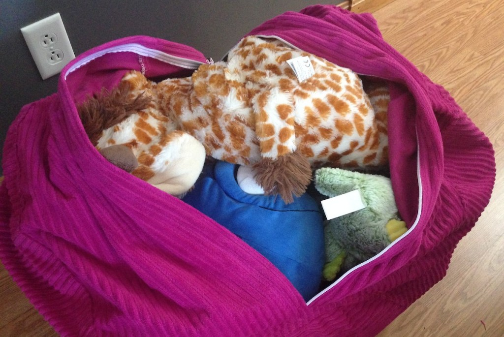 pink purple bean bag chair filled with various stuffed animals