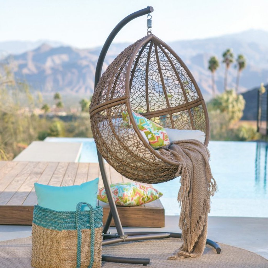 wicker hanging egg chair + stand by pool