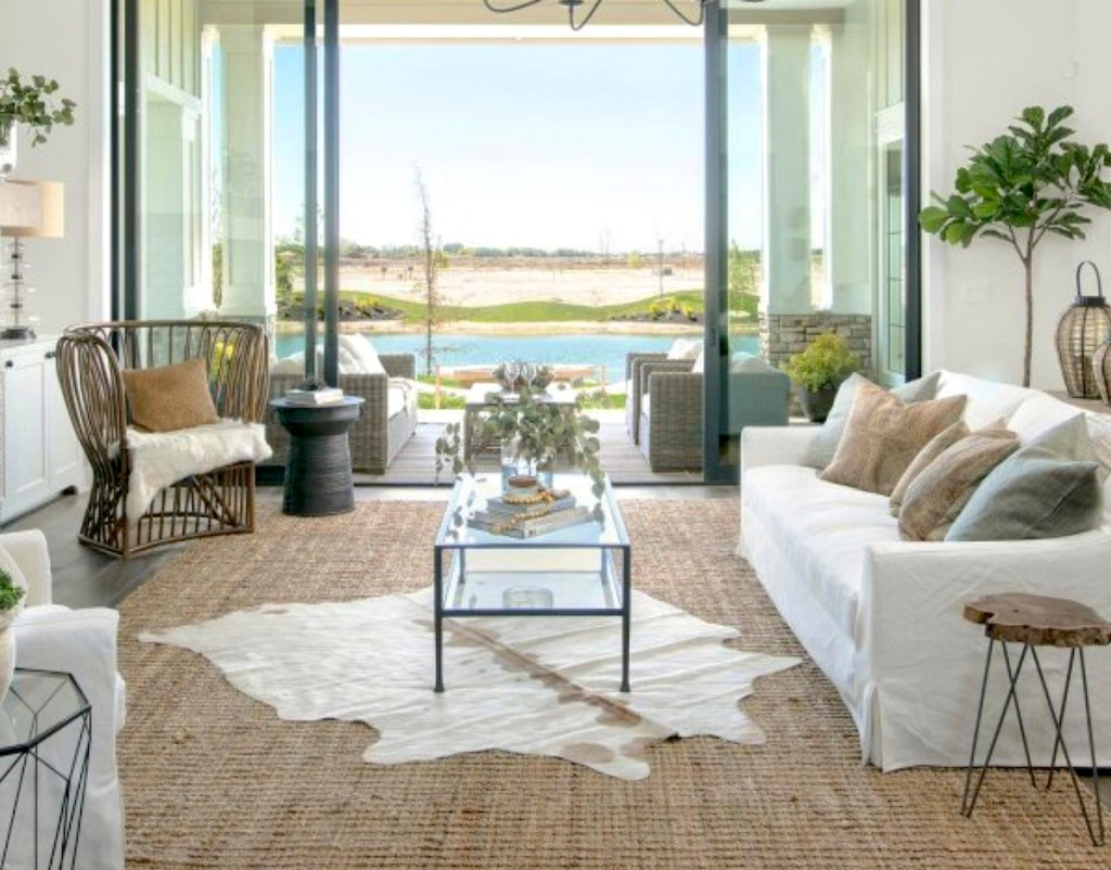 beautiful coastal living room with white furniture and great views outside