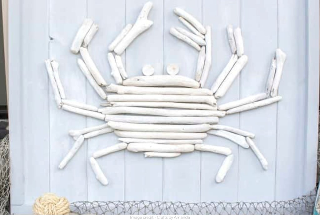 white driftwood crab on wood pallet frame