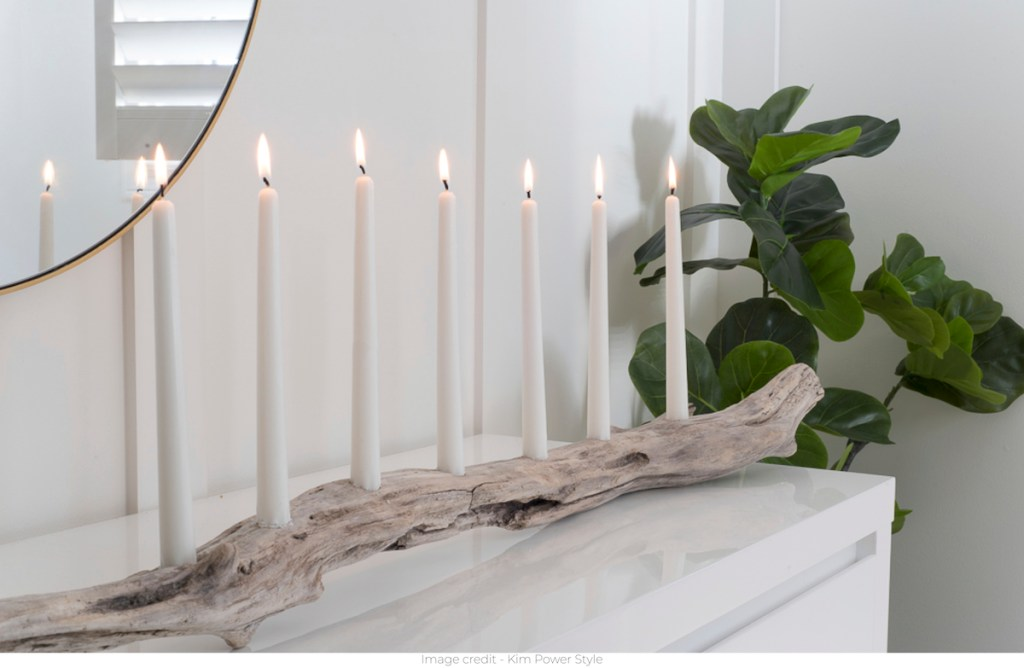 driftwood candle holder on white glossy surface