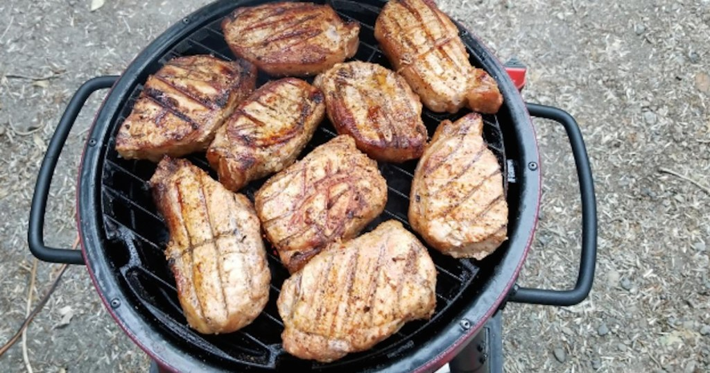 chicken breasts cooking on a grill