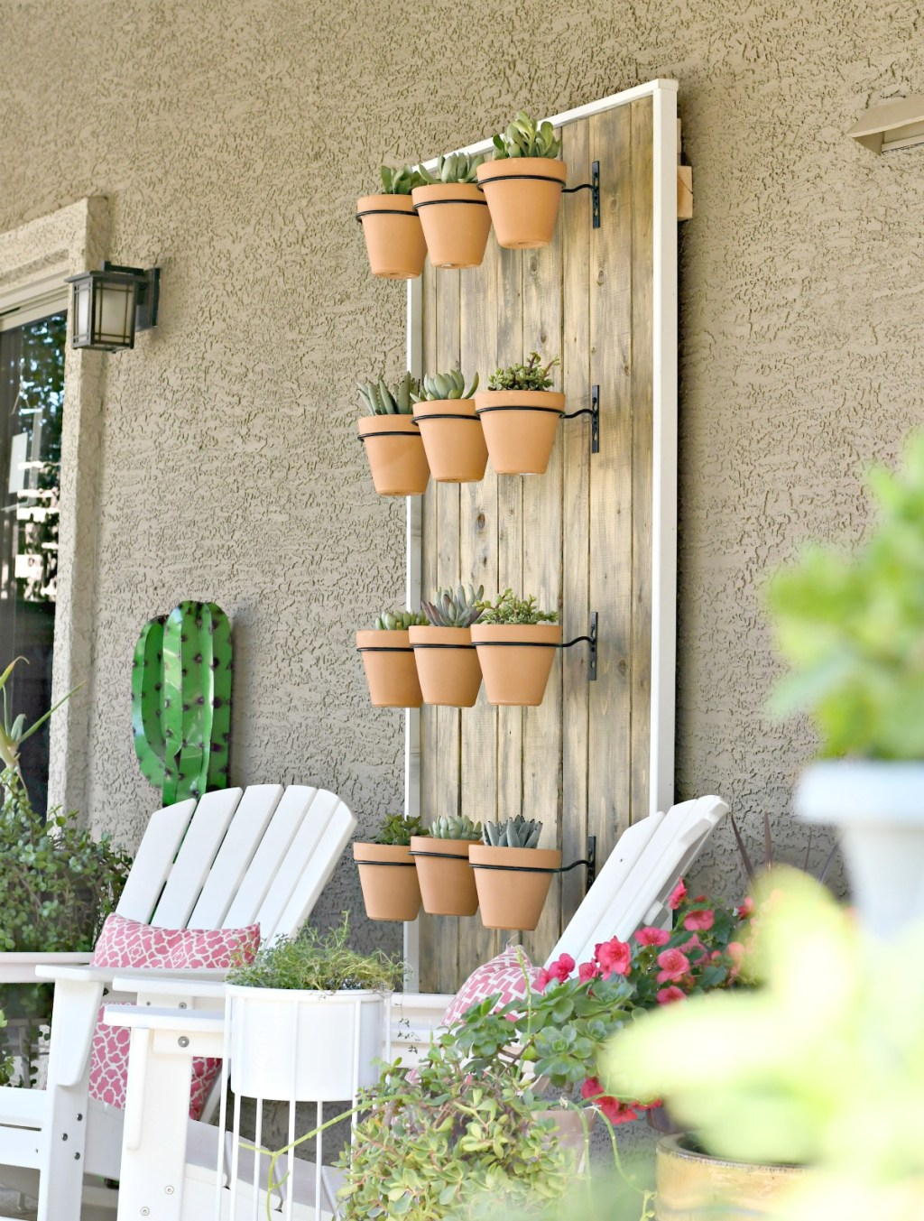 hanging display of potted succulents on the way
