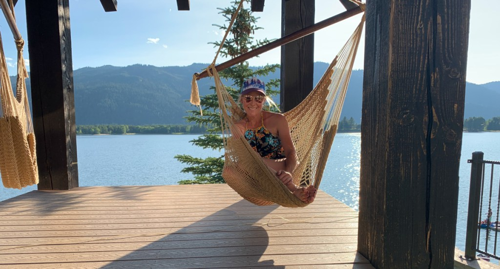 woman sitting in hammock chair