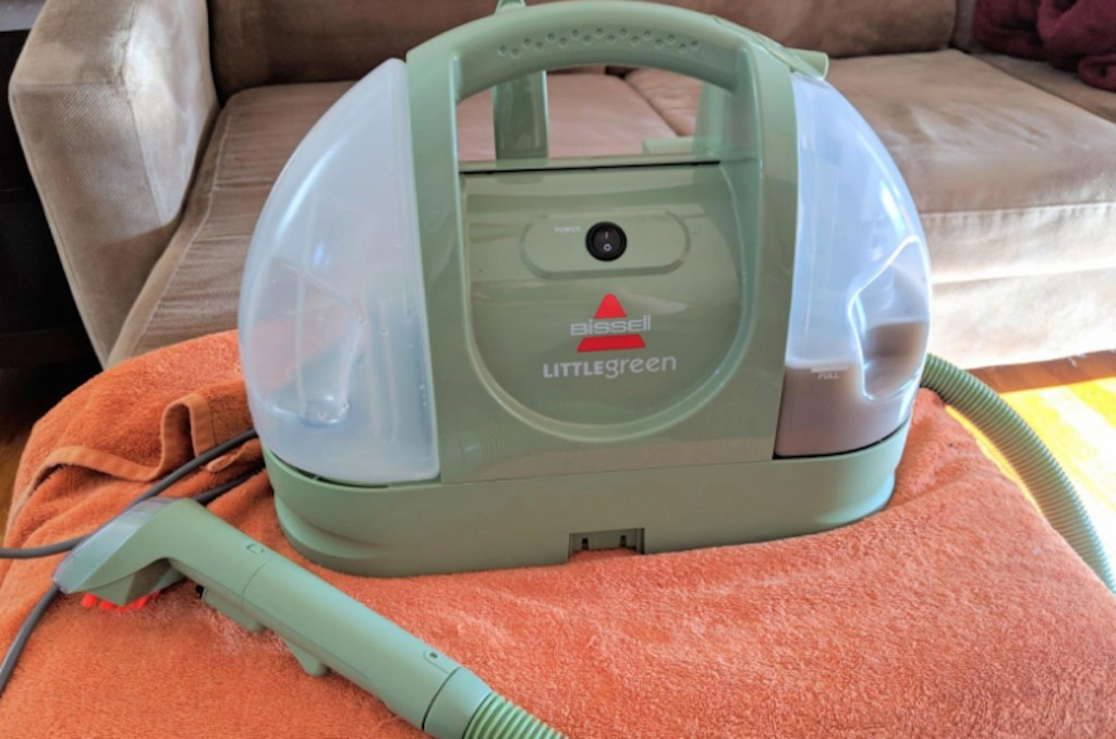 green bissell spot cleaner on orange towel