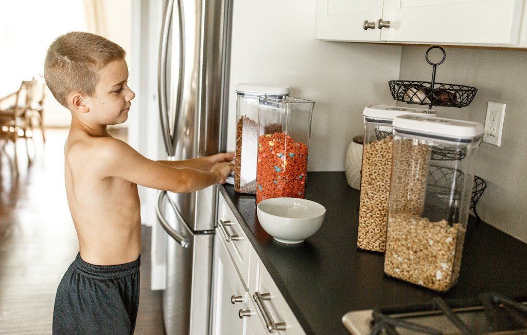 boy with cereal oxo containers