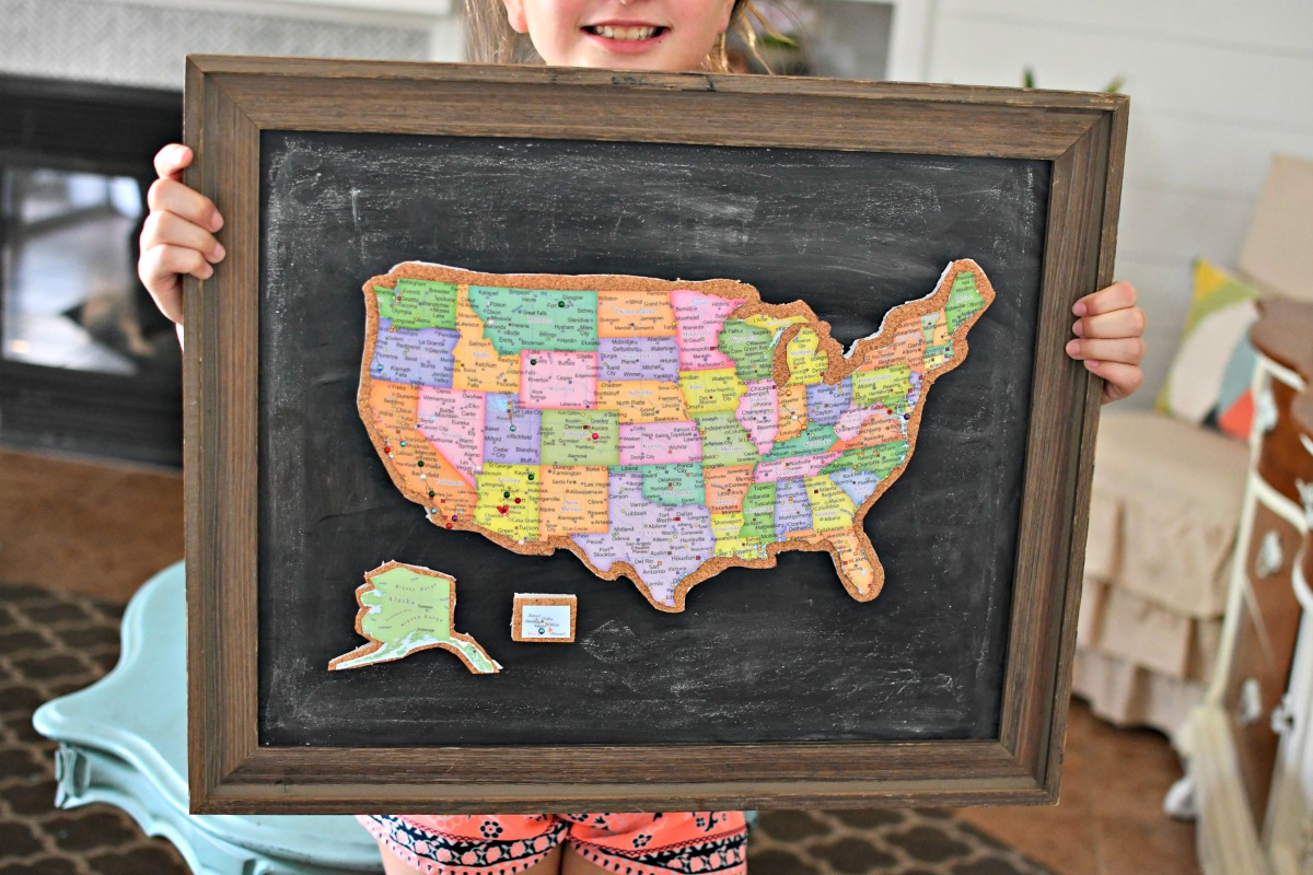 holding framed cork board travel map