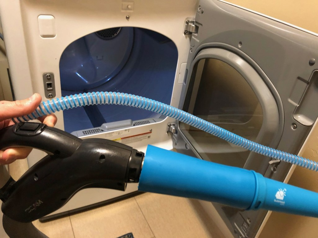blue attachment on vacuum wand with dryer in background