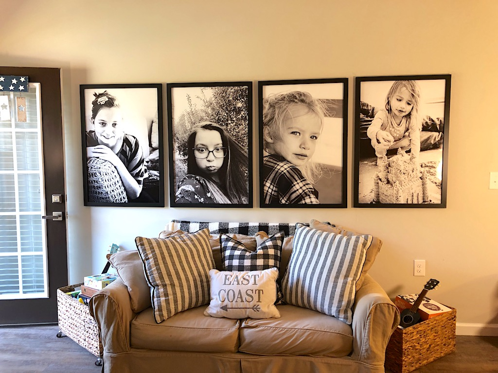 large photo gallery wall in living room