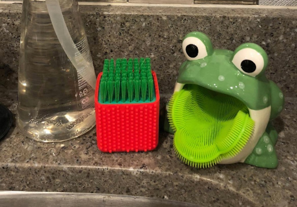 frog with silicone scrub brush on sink