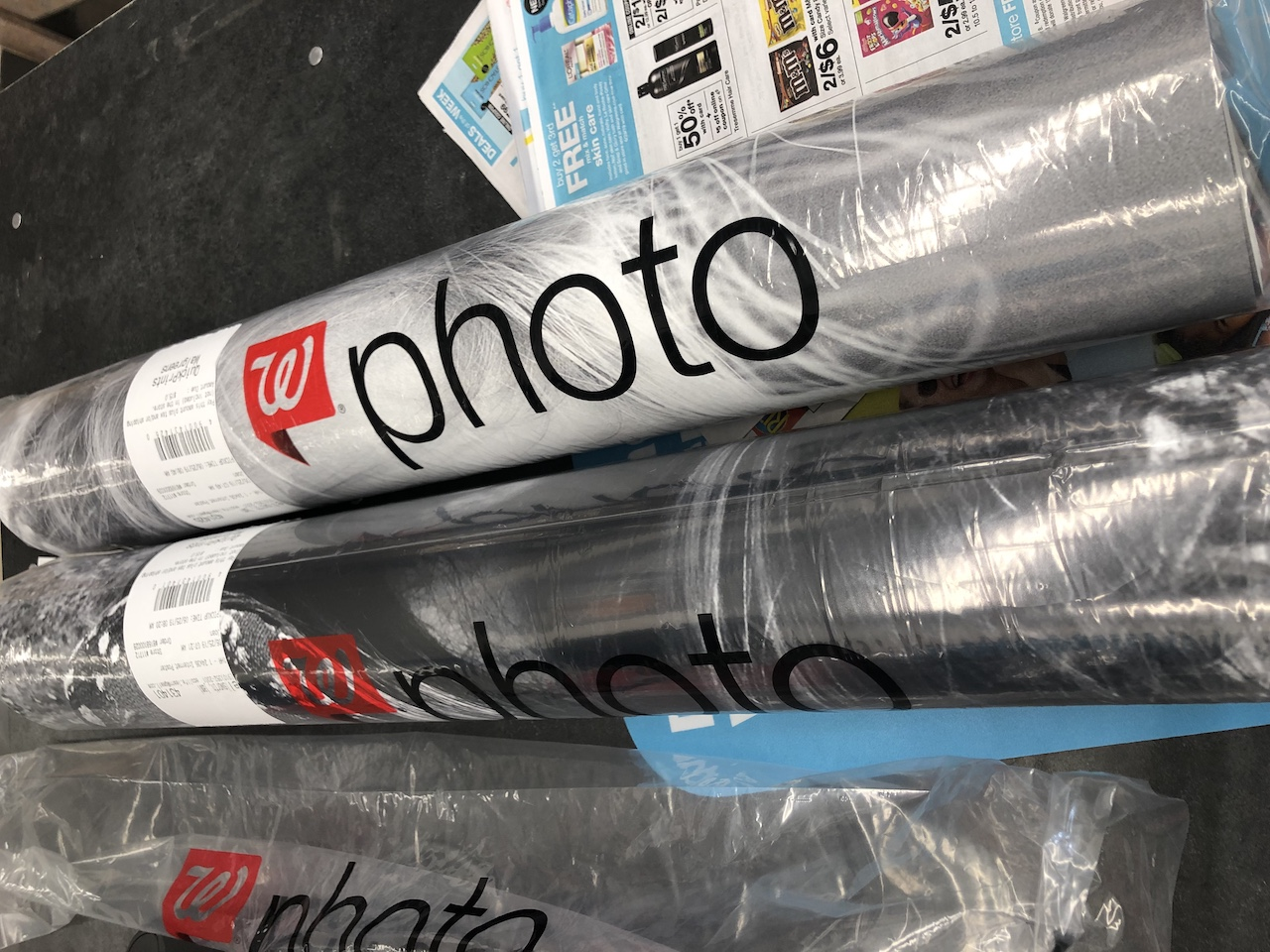 Walgreens poster prints rolled up on counter