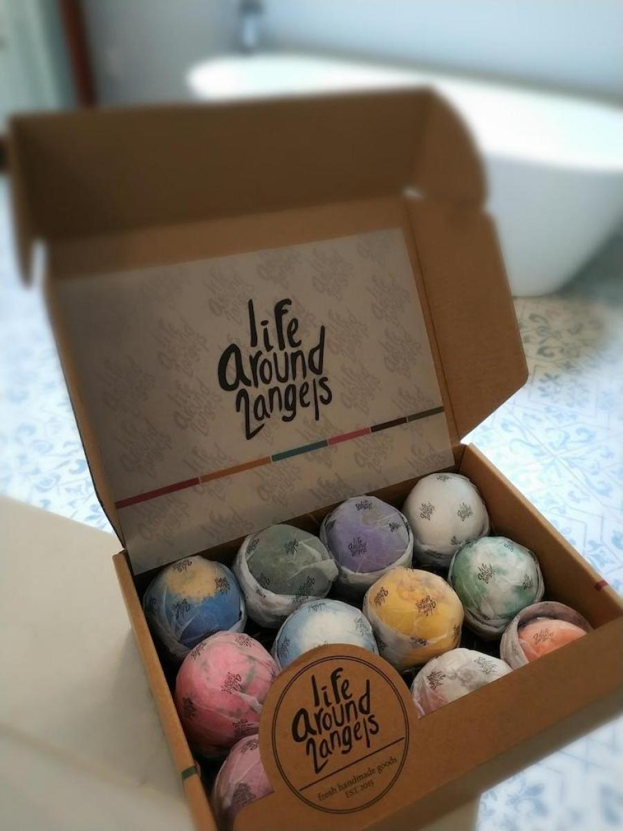 bath bombs set in box sitting in bathroom