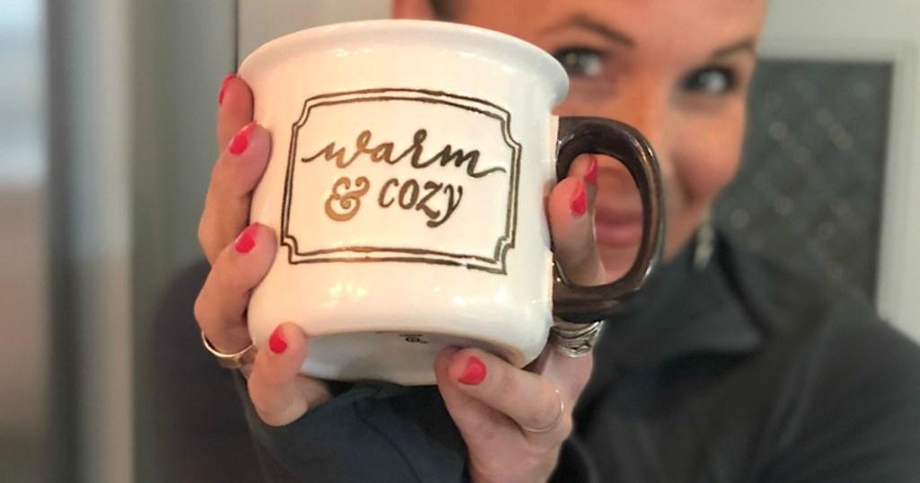 woman living Hygge lifestyle holding warm and cozy mug