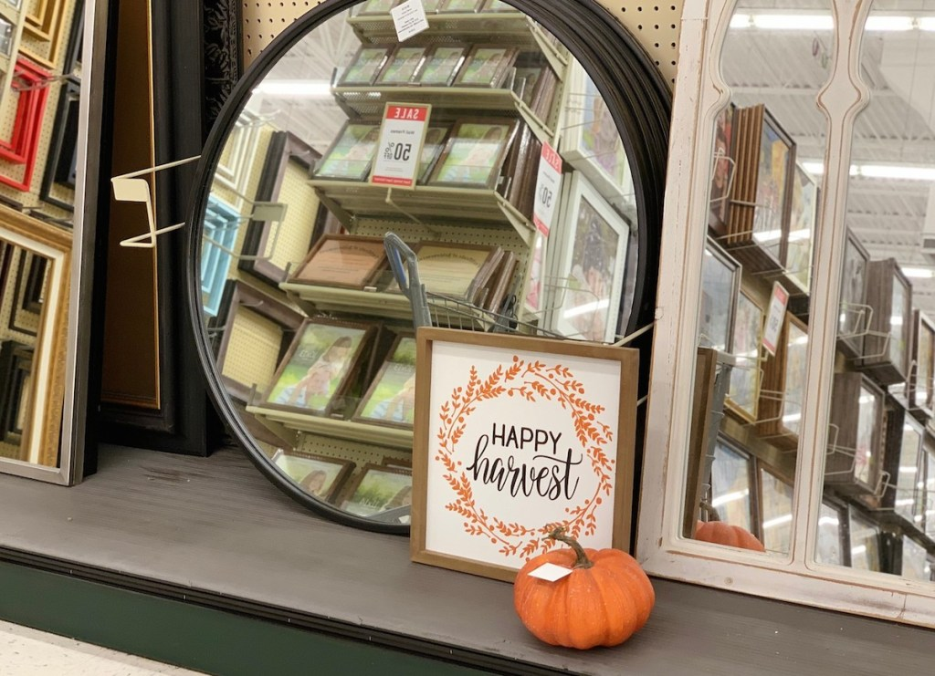 round mirrors in store with orange fall wall decor