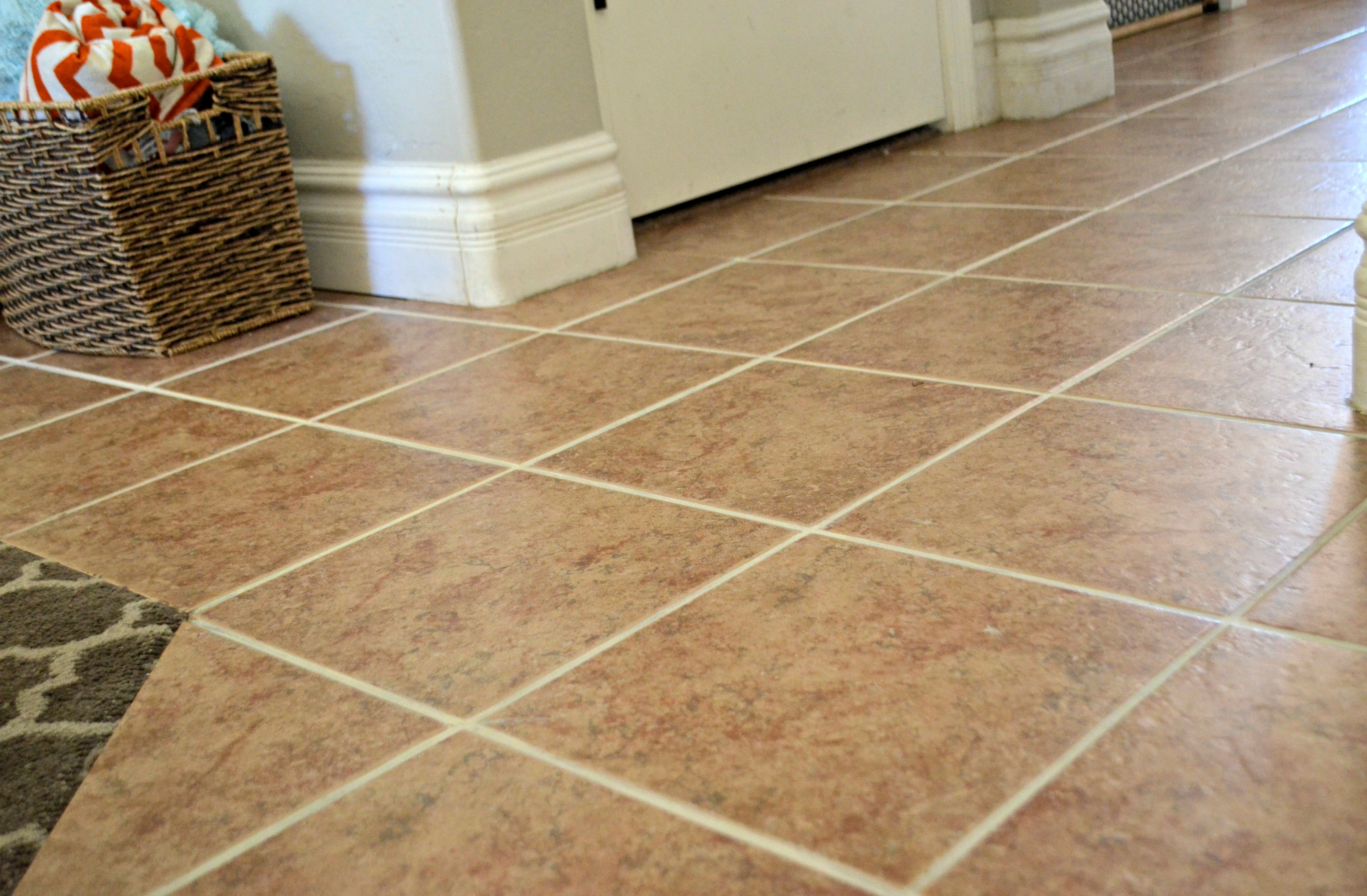 closeup of the tile floor after cleaning the grout