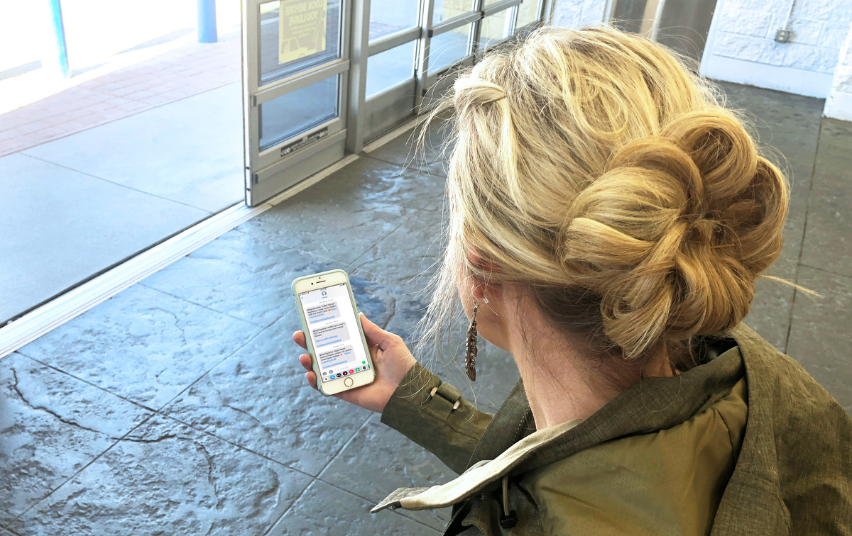 Sign up for text messaging of hot deals & never miss a hot deal again collin looking at her phone