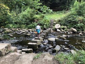 Boy on stepping stones at Hardcastle crags