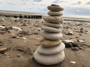 Close up of pebbles stacked on top of each other on the beach. Bridlington.