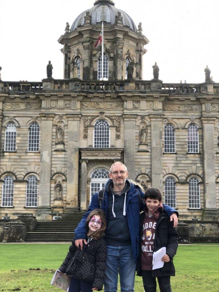 Hip2trek family stand outside Castle Howard