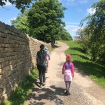 Hip2trek family walk along tree lined walled path