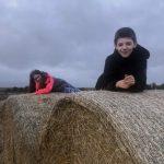Hip2trek kids on laid on hay bales