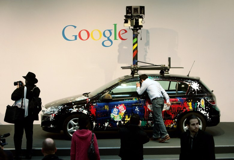 HANNOVER, GERMANY - MARCH 03:  People gather in front of a German Google Street View car at the Google stand at the CeBIT Technology Fair on March 3, 2010 in Hannover, Germany. Google's Street View project has raised controversy from people across Europe worried about infringement of their privacy. CeBIT will be open to the public from March 2 through March 6.  (Photo by Sean Gallup/Getty Images)