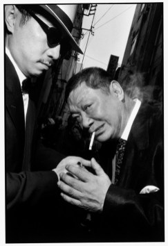 JAPAN. Asakasa. 1998. George Abe, right, an ex-Yakuza member and celebrity writer. Yakuza model themselves on American gangster fashion from 1950s.