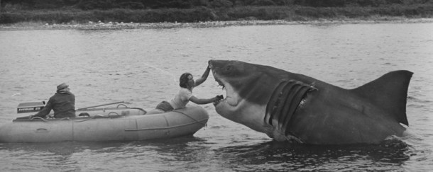 """An undated handout picture shows a 1974 photo of a man preparing the mechanical shark during the shooting of the film """"Jaws"""" at Martha's Vineyard"""