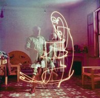 Triple exposure of artist Pablo Picasso drawing w. light at his home in Vallauris. (Photo by Gjon Mili/The LIFE Picture Collection/Getty Images)
