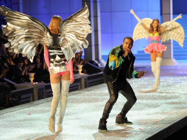 Kanye West performs as a model wears lingerie during the Victoria's Secret Fashion Show on November 9, 2011 in New York. The show will be broadcast on November 29 on CBS.     AFP PHOTO/TIMOTHY A. CLARY (Photo credit should read TIMOTHY A. CLARY/AFP/Getty Images)