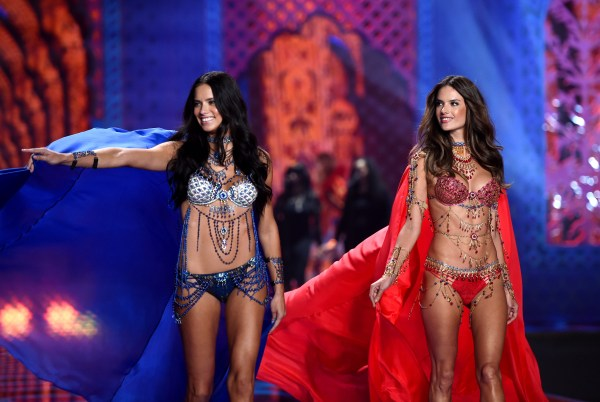LONDON, ENGLAND - DECEMBER 02:  Adriana Lima and Alessandra Ambrosio walk the runway at the annual Victoria's Secret fashion show at Earls Court on December 2, 2014 in London, England.  (Photo by Karwai Tang/WireImage)