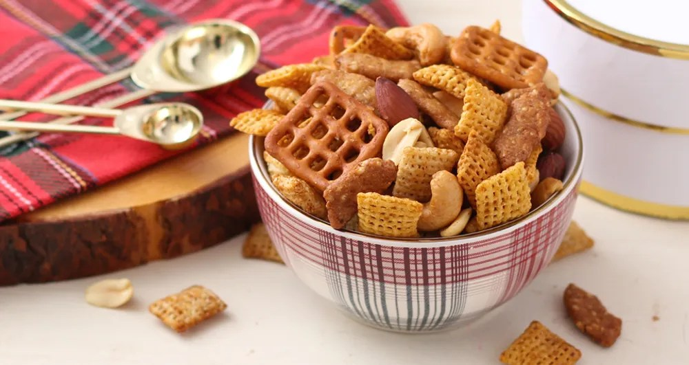 Sesame Ginger Chex Party Mix! Try this new delicious twist on your traditional party Chex mix! Start a new holiday tradition with this bold recipe, including the flavors of soy sauce, hoisin, sesame sticks, and ginger!!