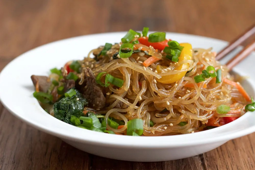 Japchae: Korean Stir Fried Noodles! One of my favorite Korean dishes and so easy to make! I hope you give this recipe a try!