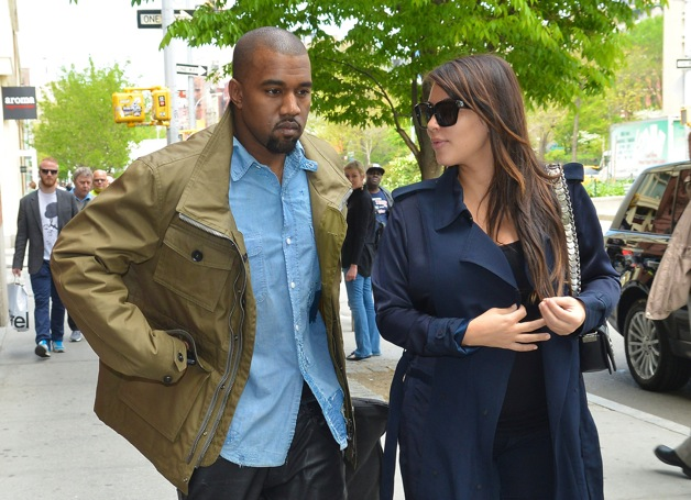 Pregnant Kim Kardashian and her rapper beau Kanye West are seen walking around Soho, NYC
