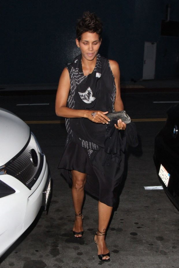 Actress Halle Berry wearing a black outfit with a skull tattoo on her hand, seen leaving the Chi Lin Restaurant with friends in Los Angeles