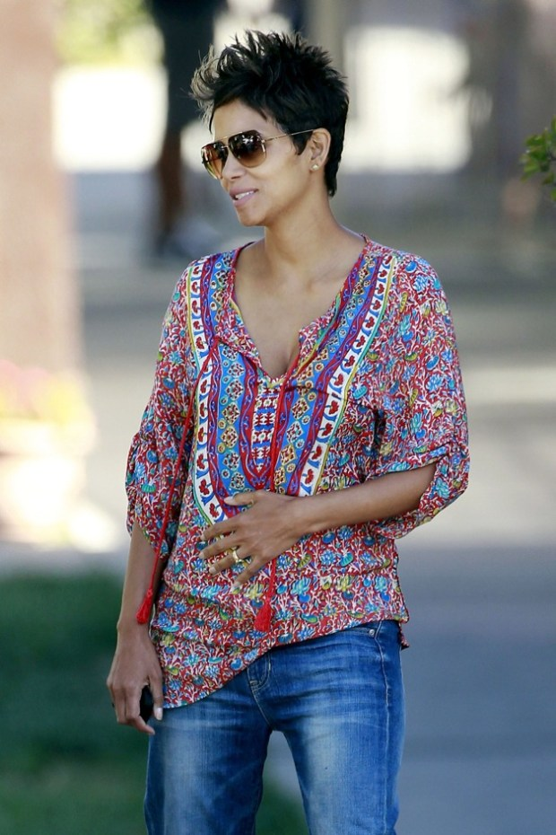Halle Berry shows off her baby bump in a red printed top as she drops daughter Nahla off at school in Los Angeles