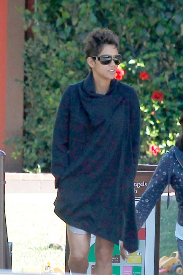 Halle Berry covers her expanding baby bump with a loose black sweater, as she drops off her daughter Nahla at school in Los Angeles