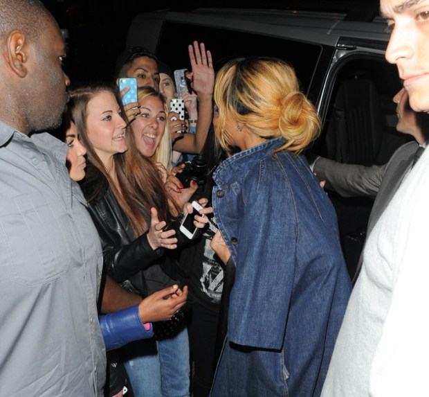 Rihanna is swarmed by excited fans as she makes her way into San Carlo restaurant in Manchester