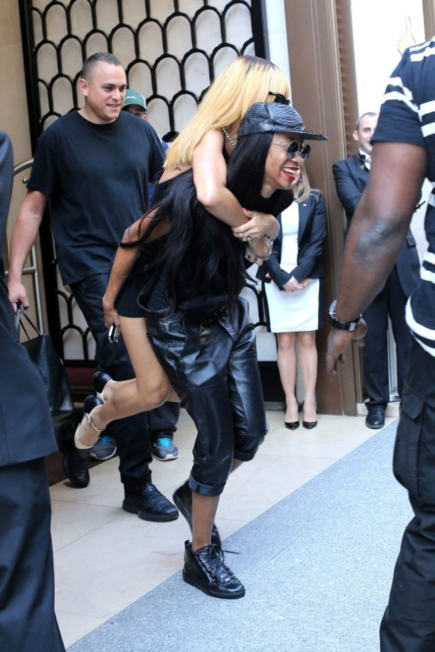 Rihanna gets a piggy back from best friend Melissa Forde, as she leaves her hotel in Paris