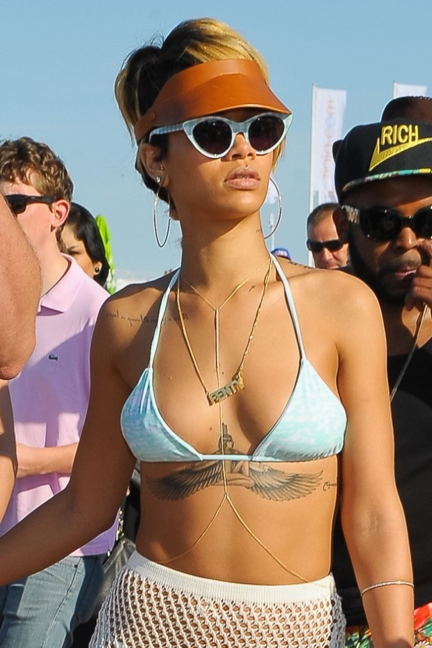 Rihanna shows off her bikini body as she hits the beach with a female pal in Sopot, Poland