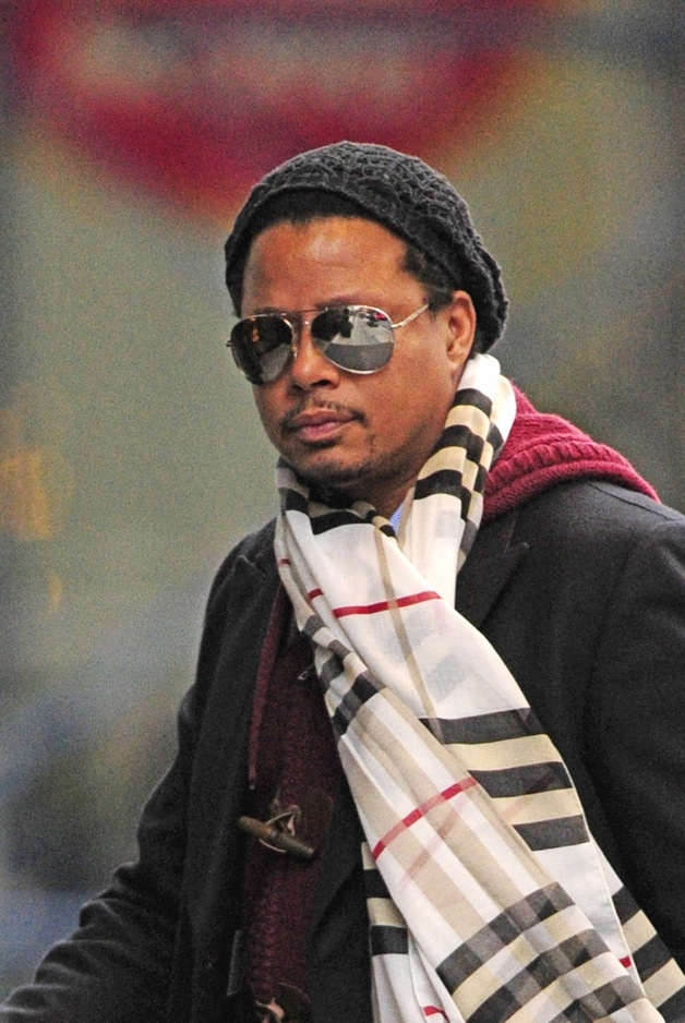 Terrence Howard wears a Burberry scarf while arriving at the Trump SoHo hotel in New York City