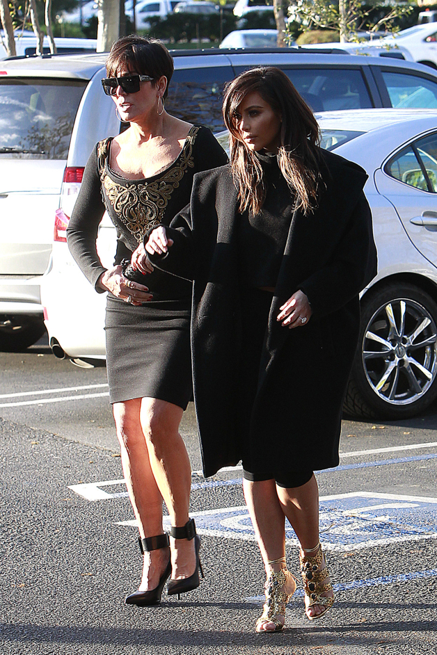 Kim and Khloe Kardashian are joined by their mom Kris Jenner for a meal at Fins in Los Angeles