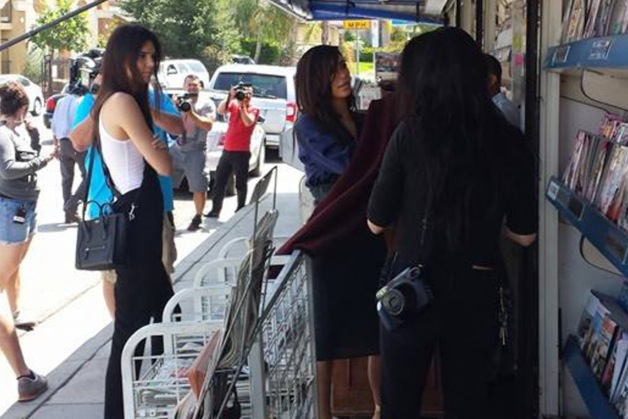 Kim Kardashian and Kendall Jenner seen flipping through magazines next to a newsstand in Woodland Hills
