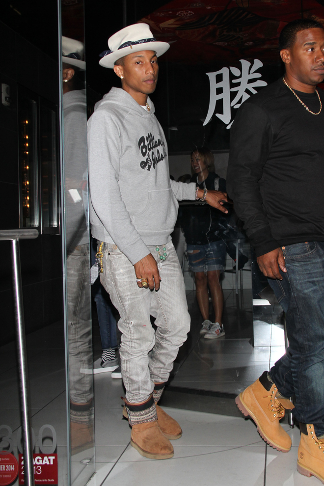 EXCLUSIVE: Pharrell Williams shows off his new hat as he leaves Katsuya Hollywood in Los Angeles