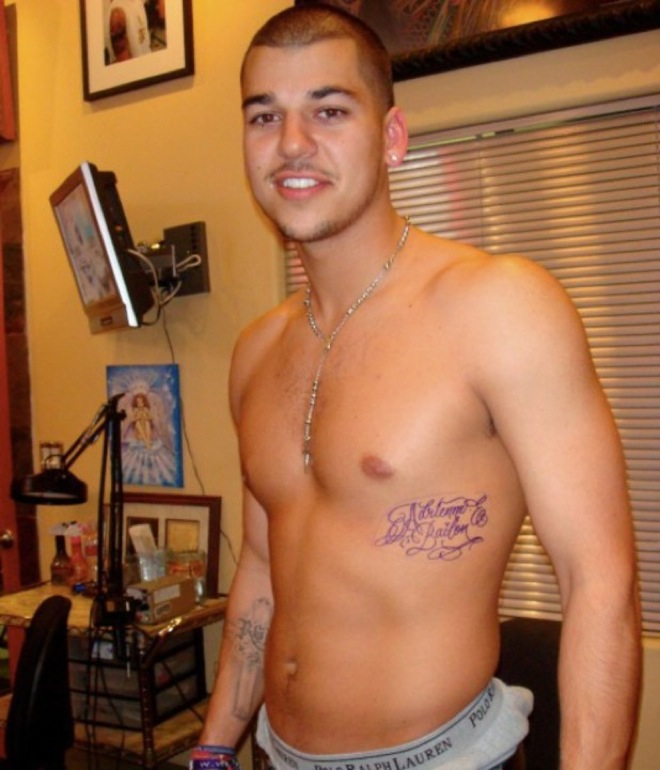 After just a few months of dating, Robert Kardashian tattooed his then girlfriend, Adrienne Bailon's name across his rib.