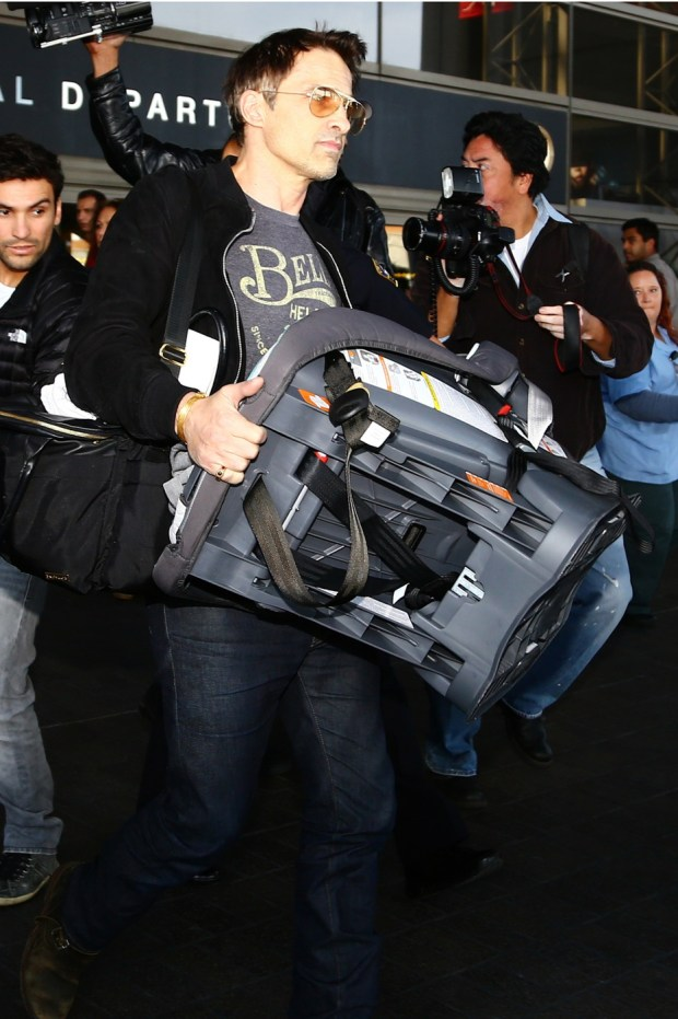 Olivier Martinez with the car seat he allegedly shoved into a LAX employee.
