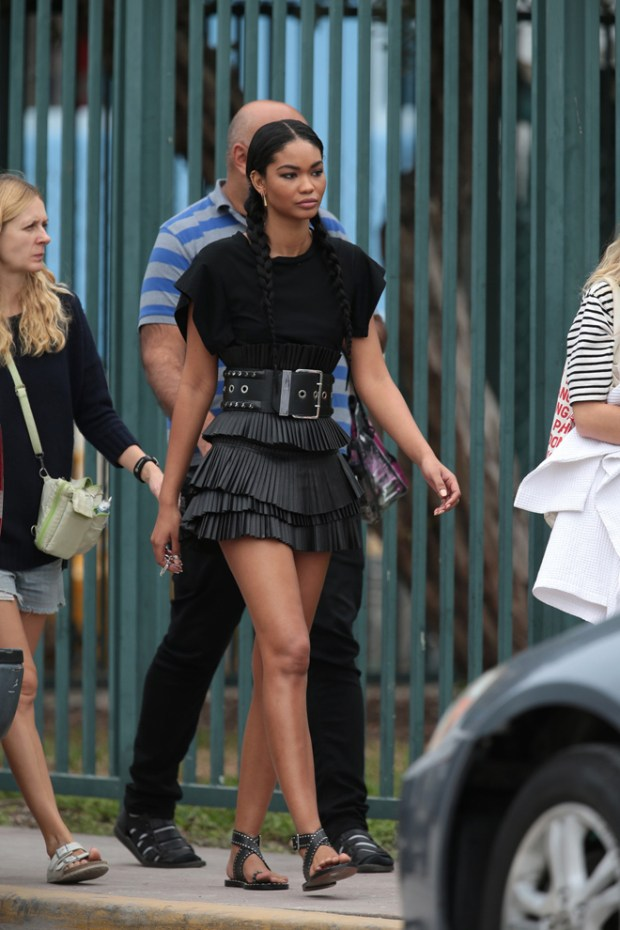 EXCLUSIVE: FROM RUNWAY TO RACETRACK: Chanel Iman models several high fashion outfits during a photo shoot on a running track at a local park on Miami's South Beach