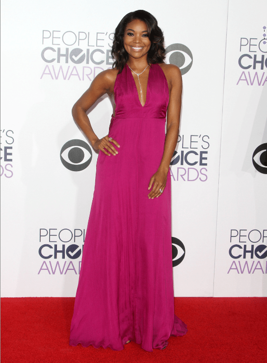 Dressed by Rachel Zoe, Gabrielle Union stunned in thismagenta Honour gown that showed off her tone arms and back.