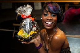 Algebra receives a Hennessy gift basket backstage at the Vail Soul Music Fest